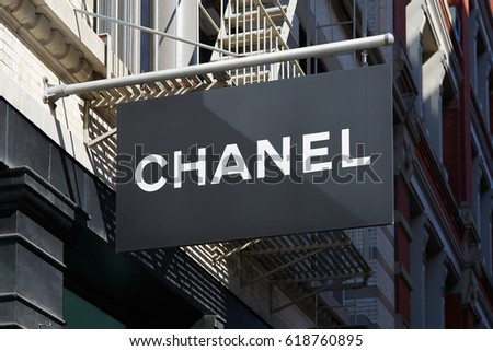 NEW YORK - SEPTEMBER 7: Chanel store black sign in 139 Spring St, Soho in a sunny day on September 7, 2016 in New York. Chanel is a fashion house founded in 1909.