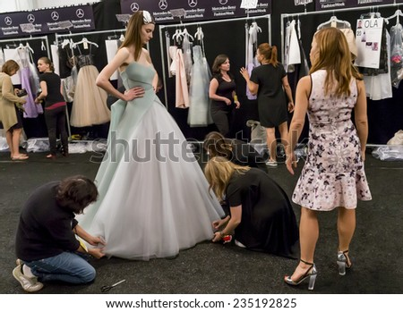 New York - September 05, 2014: Designer Monique Lhuillier supervises the fitting at the Monique Lhuillier Spring 2015 fashion show during Mercedes-Benz Fashion Week at The Theatre at Lincoln Center - stock photo