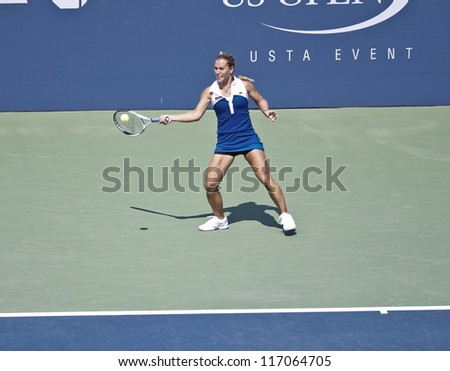 NEW YORK - SEPTEMBER 1: Dominika Cibulkova of Slovakia returns ball during 3rd round match against Roberta Vinci of Italy at US Open tennis tournament on September 1, 2012 in Flushing Meadows New York