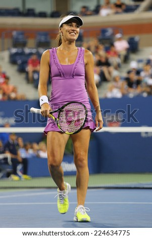 NEW YORK - SEPTEMBER 6 Five times Grand Slam champion Martina Hingis during final doubles match at US Open 2014 at Billie Jean King National Tennis Center on September 6, 2014 in New York  - stock photo