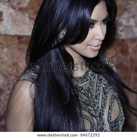NEW YORK - SEPTEMBER 14: Kim Kardashian attends runway show by Sherri Hill at Mercedes-Benz Spring/Summer 2012 Fashion Week in Trump Tower on September 14, 2011 in New York City