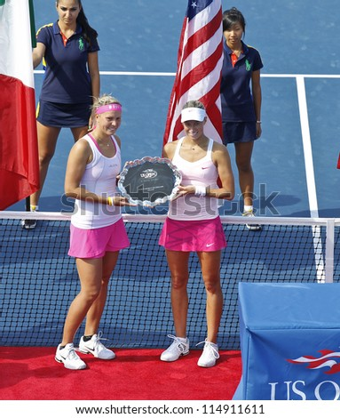 NEW YORK - SEPTEMBER 9: Lucie Hradecka/Andrea Hlavackova of Czech Republic with women doubles runner-up trophy after lost to Roberta Vinci/Sara Errani of Italy at US Open tennis on Sep 9, 2012 in NYC