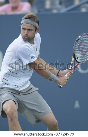 NEW YORK - SEPTEMBER 01: Mardy Fish of USA returns ball during 2nd round match against Malek Jaziri of Tunisia at USTA Billie Jean King National Tennis Center on September 01, 2011 in New York City, NY.