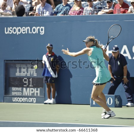 NEW YORK - SEPTEMBER 04: Maria Sharapova of Russia returns a ball during match against Beatrice Capra of USA at US Open Tennis Championship on September 04, 2010 in New York, City. - stock photo