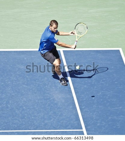 NEW YORK - SEPTEMBER 11: Mikhail Youzhny of Russia returns the ball during match against Rafael Nadal of Spain at US Open Tennis Championship on September 11, 2010 in New York, City.