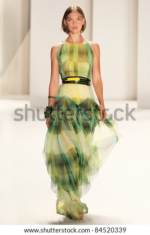 NEW YORK - SEPTEMBER 12: Model Arizona Muse walks the runway at the Carolina Herrera S/S 2012 collection presentation during Mercedes-Benz Fashion Week on September 12, 2011 in New York. - stock photo