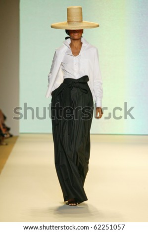 NEW YORK - SEPTEMBER 13: Model Arlenis Sosa walks the runway at Carolina Herrera collection  for Spring/Summer 2011 during Mercedes-Benz Fashion Week on September 13, 2010 in New York