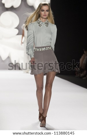 NEW YORK - SEPTEMBER 10: Model Frida Aasen walks the runway at the Carolina Herrera S/S 2013 collection presentation during Mercedes-Benz Fashion Week on September 10, 2011 in New York. - stock photo