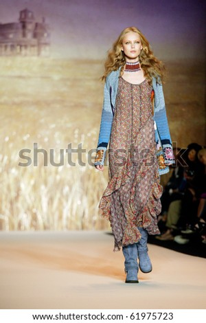 NEW YORK - SEPTEMBER 15: Model Frida Gustavsson walks the runway at the Anna Sui collection presentation for Spring/Summer 2011 during Mercedes-Benz Fashion Week on September 15, 2010 in New York - stock photo