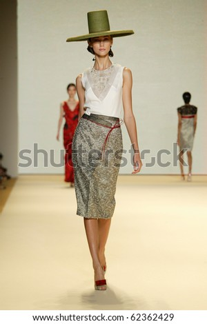 NEW YORK - SEPTEMBER 13: Model Ksenia Kahnovich walks the runway at Carolina Herrera collection presentation for Spring/Summer 2011 during Mercedes-Benz Fashion Week on September 13, 2010 in New York
