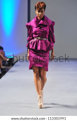 NEW YORK- SEPTEMBER 17: Model walks runway at the Pilar Macchione show at Waldorf Astoria for S/S 2013 during Couture Fashion Week on September 17, 2012 in New York City, NY - stock photo