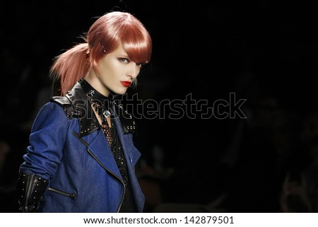 NEW YORK - SEPTEMBER 12: Model walks the runway at the Anna Sui Spring Summer 2013 Collection presentation during Mercedes-Benz Fashion Week on September 12, 2012 at Lincoln Center in New York - stock photo