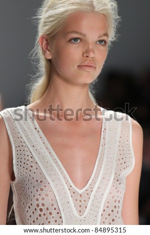 NEW YORK - SEPTEMBER 13: Model walks the runway at the Vera Wang S/S 2012 collection presentation during Mercedes-Benz Fashion Week on September 13, 2011 in New York. - stock photo