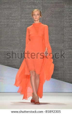NEW YORK - SEPTEMBER 10: Model walks the runway at the Vivienne Tam Spring / Summer 2012 collection presentation during Mercedes-Benz Fashion Week on September 10, 2011 in New York. - stock photo