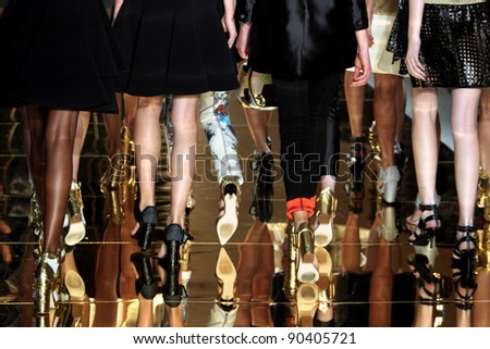 NEW YORK - SEPTEMBER 9: Models walk the runway at the Cynthia Rowley S/S 2012 collection presentation during Mercedes-Benz Fashion Week on September 9, 2011 in New York - stock photo