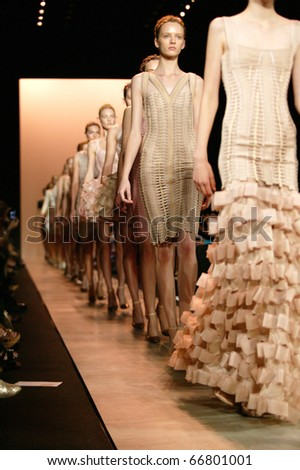 NEW YORK - SEPTEMBER 14: models walk the runway at the Herve Leger Collection presentation for Spring/Summer 2011 during Mercedes-Benz Fashion Week on September 14, 2010 in New York. - stock photo