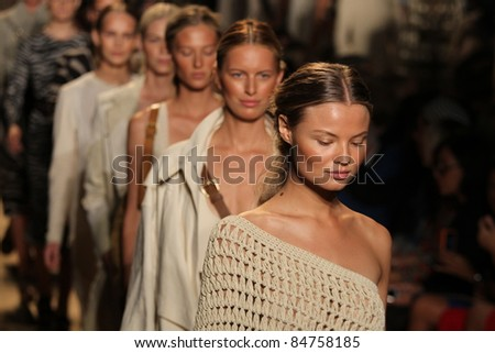 NEW YORK - SEPTEMBER 14: Models walk the runway at the Michael Kors S/S 2012 collection presentation during Mercedes-Benz Fashion Week on September 14, 2011 in New York. - stock photo