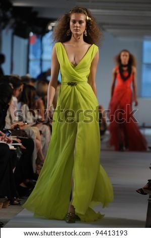NEW YORK - SEPTEMBER 13: Models walk the runway at the Oscar De La Renta Spring/Summer 2012 collection during New York Fashion Week on September 13, 2011 in New York City. - stock photo
