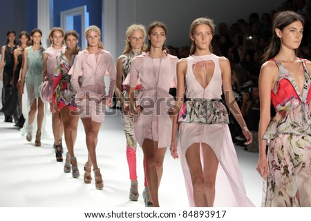 NEW YORK - SEPTEMBER 13: Models walk the runway at the Vera Wang S/S 2012 collection presentation during Mercedes-Benz Fashion Week on September 13, 2011 in New York. - stock photo