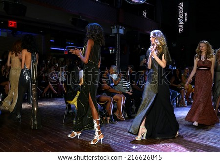 NEW YORK - SEPTEMBER 07: Models walk the runway finale  for Raul Penaranda Spring-Summer 2015 Sultry presentation at Stage 48 during New York Fashion Week on September 07, 2014 in NYC.
