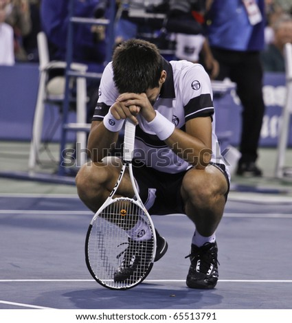 NEW YORK - SEPTEMBER 13: Novak Djokovic of Serbia reacts during final match of US Open Tennis Championship against Rafael Nadal on September 13, 2010 in New York, City. - stock photo