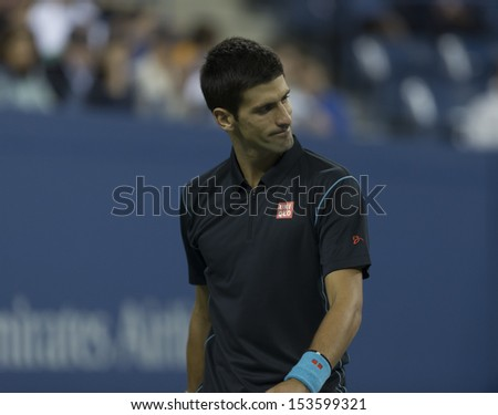 NEW YORK - SEPTEMBER 5: Novak Djokovic of Serbia reacts during quarterfinal match against Mikhail Youzhny of Russia  at USTA Billie Jean King National Tennis Center on September 5, 2013 in New York