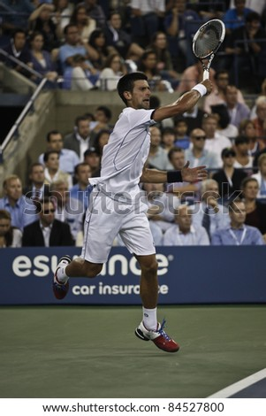 NEW YORK - SEPTEMBER 12: Novak Djokovic of Serbia returns ball during final match against Rafael Nadal of Spain at USTA Billie Jean King National Tennis Center on September 12, 2011 in NYC - stock photo