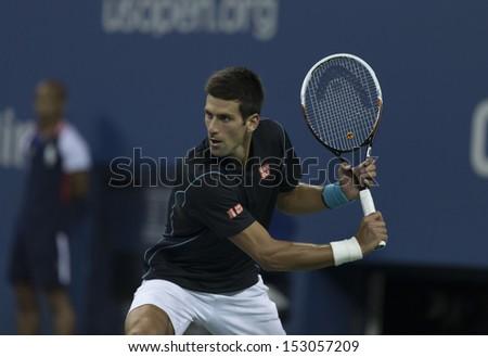 NEW YORK - SEPTEMBER 5: Novak Djokovic of Serbia returns ball during quarterfinal match against Mikhail Youzhny of Russia at USTA Tennis Center on September 5, 2013 in New York City - stock photo