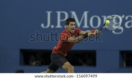 NEW YORK - SEPTEMBER 9: Novak Djokovic of Serbia returns ball during US Open final match against Rafael Nadal of Spain at USTA Billie Jean King National Tennis Center on September 9, 2013 in NYT - stock photo