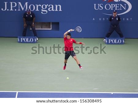NEW YORK - SEPTEMBER 9: Novak Djokovic of Serbia returns ball during US Open final match against Rafael Nadal of Spain at USTA Billie Jean King National Tennis Center on September 9, 2013 in New York - stock photo