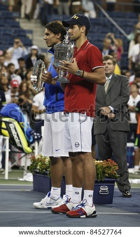 NEW YORK - SEPTEMBER 12: Novak Djokovic of Serbia winner of US Open single men championships & runner-up Rafael Nadal of Spain at USTA Billie Jean King National Tennis Center on Sep 12, 2011 in NYC - stock photo
