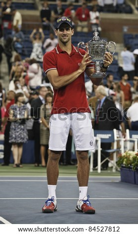 NEW YORK - SEPTEMBER 12: Novak Djokovic of Serbia winner of US Open single men championships with trophy at USTA Billie Jean King National Tennis Center on September 12, 2011 in NYC - stock photo