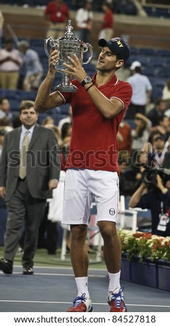 NEW YORK - SEPTEMBER 12: Novak Djokovic of Serbia winner of US Open single men championships with trophy at USTA Billie Jean King National Tennis Center on September 12, 2011 in NYC - stock photo