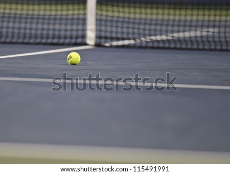 NEW YORK - SEPTEMBER 03: Official Wilson tennis ball laying on the court at US Open tennis tournament on September 3, 2012 in Flashing New York - stock photo