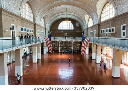 NEW YORK - SEPTEMBER 02: Overview of Tourists in Great Hall of Ellis Island Immigration Museum - Historic Location Where New Immigrants Were Processed - New York City, USA. September 02, 2015. - stock photo