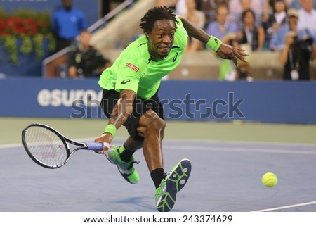 NEW YORK - SEPTEMBER 4, 2014: Professional tennis player Gael Monfis during quarterfinal match against seventeen times Grand Slam champion Roger Federer at US Open 2014 at National Tennis Center  - stock photo