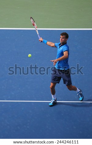 NEW YORK -SEPTEMBER 2, 2014: Professional tennis player Grigor Dimitrov from Bulgaria during round 4 match against Gael Monfils  at Billie Jean King National Tennis Center in New York