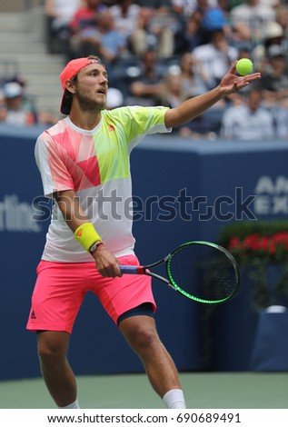 NEW YORK - SEPTEMBER 6, 2016: Professional tennis player Lucas Pouille of France in action during his US Open 2016 quarterfinal match at National Tennis Center