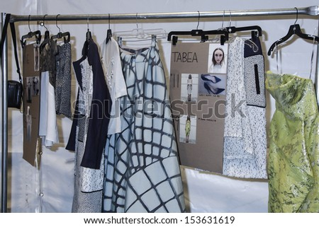 NEW YORK - SEPTEMBER 8: Rack with dress on backstage for Lela Rose Spring/Summer 2014 collection at Mercedes-Benz  Fashion Week at Studio at Lincoln Center on September 8, 2013 in NYC - stock photo