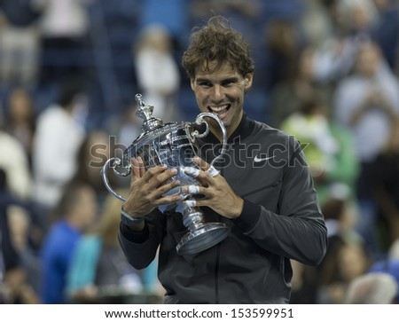 NEW YORK - SEPTEMBER 9: Rafael Nadal of Spain poses with trophy after winning final against Novak Djokovic if Serbia at USTA Billie Jean King National Tennis Center on September 9, 2013 in New York - stock photo