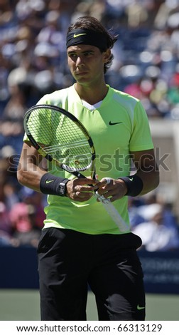 NEW YORK - SEPTEMBER 11: Rafael Nadal of Spain reacts during match against Mikhail Youzhny of Russia at US Open Tennis Championship on September 11, 2010 in New York, City. - stock photo