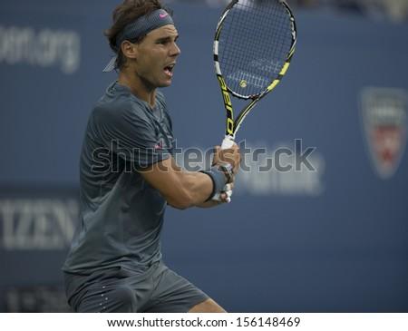 NEW YORK - SEPTEMBER 9: Rafael Nadal of Spain reacts during US Open final match against Novak Djokovic of Serbia at USTA Billie Jean King National Tennis Center on September 9, 2013 in New York City - stock photo