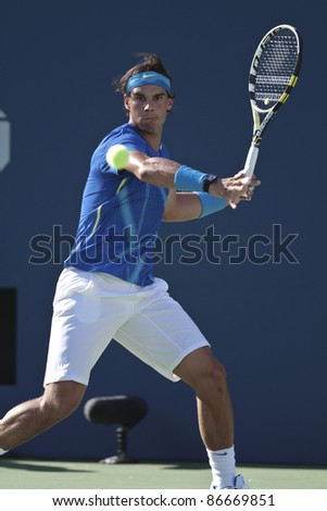 NEW YORK - SEPTEMBER 09: Rafael Nadal of Spain returns ball during quarterfinal match against Andy Roddick of USA at USTA Billie Jean King National Tennis Center on September 09, 2011 in New York City, NY - stock photo