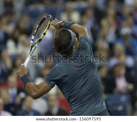 NEW YORK - SEPTEMBER 9: Rafael Nadal of Spain returns ball during US Open final match against Novak Djokovic of Serbia at USTA Billie Jean King National Tennis Center on September 9, 2013 in NNYC - stock photo