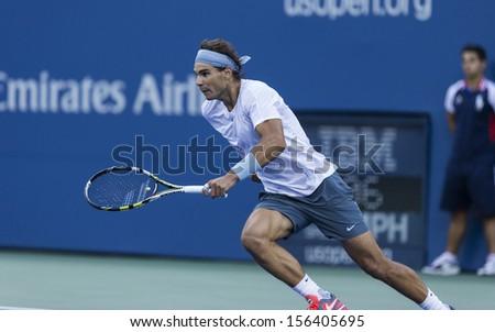 NEW YORK - SEPTEMBER 7: Rafael Nadal of Spain returns ball during US Open semifinal match against Richard Gasquet of France at USTA Billie Jean King National Tennis Center on September 7, 2013 in NYC - stock photo