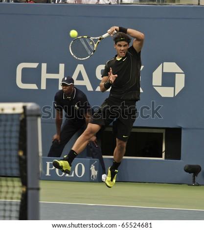 NEW YORK - SEPTEMBER 13: Rafael Nadal of Spain returns the ball during final match of US Open Tennis Championship against Novak Djokovic of Serbia on September 13, 2010 in New York, City. - stock photo