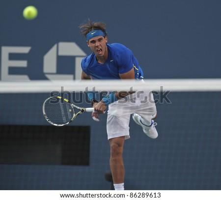 NEW YORK - SEPTEMBER 12: Rafael Nadal returns ball during final match against Novak Djokovic of Serbia at USTA Billie Jean King National Tennis Center on September 12, 2011 in NYC - stock photo