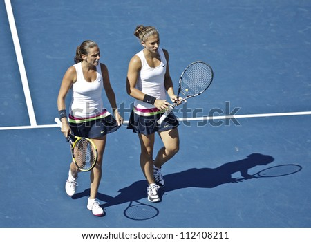 NEW YORK - SEPTEMBER 9: Roberta Vinci/Sara Errani of Italy react during final match against Lucie Hradecka/Andrea Hlavackova of Czech Republic at US Open tennis tournament on September 9, 2012 in NYC