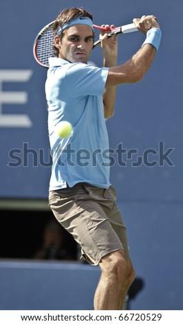 NEW YORK - SEPTEMBER 04: Roger Federer of Switzerland returns a ball during match against Paul-Henry Mathieu of France at US Open Tennis Championship on September 04, 2010 in New York, City. - stock photo