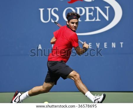 NEW York - September 5: Roger Federer of Switzerland returns a shot during 3rd round match against Lleyton Hewitt of Australia at US Open on September 5 2009 in New York - stock photo
